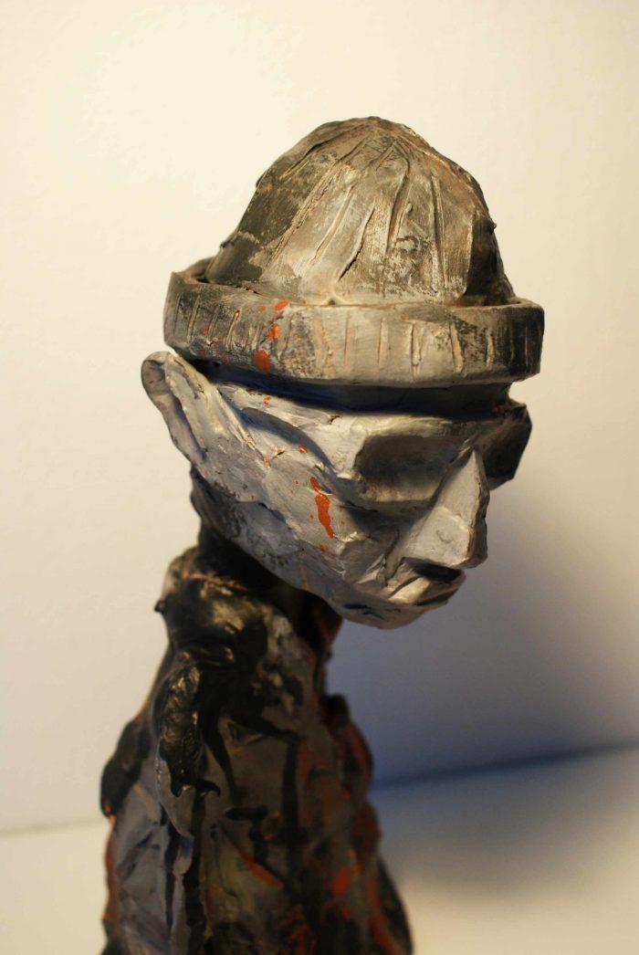Skulptur der viser en moderne far