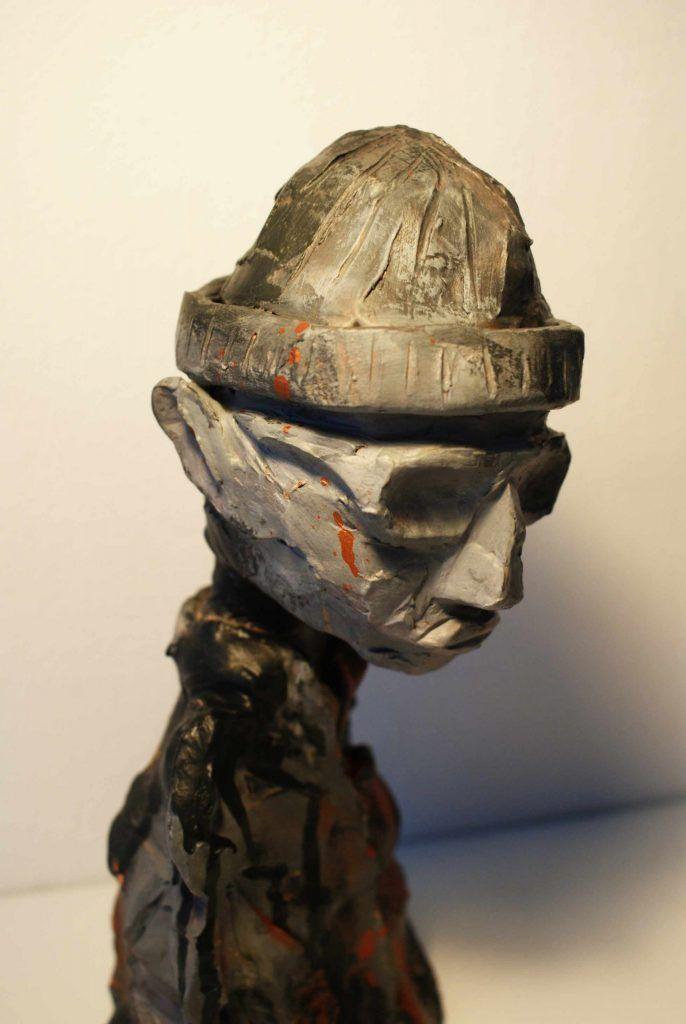 Skulpturer der viser en moderne far